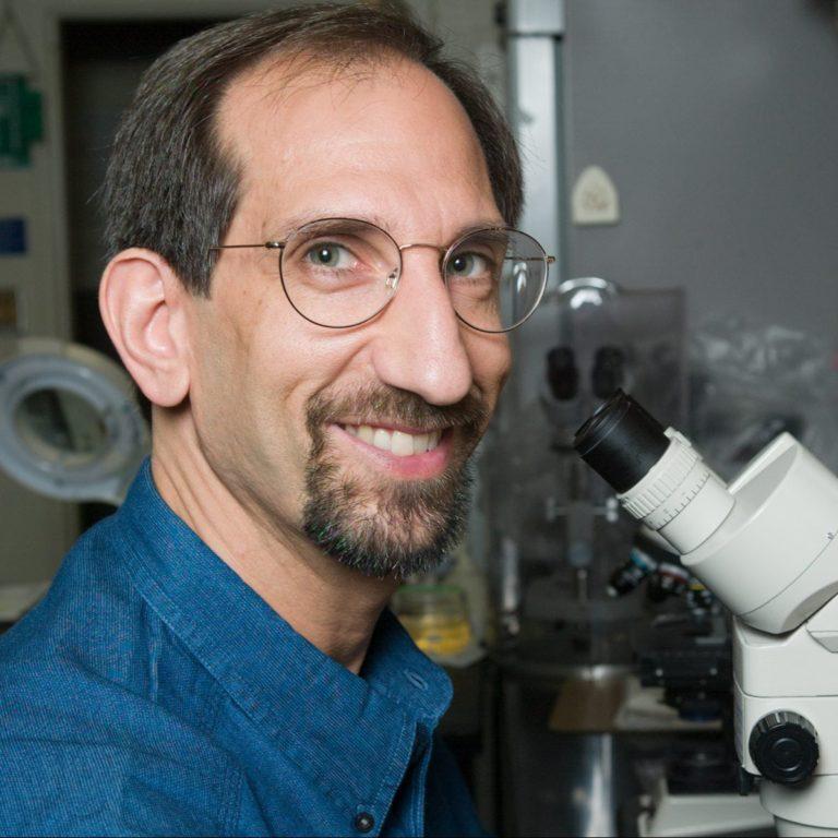 photo: Ray Kaplan at microscope
